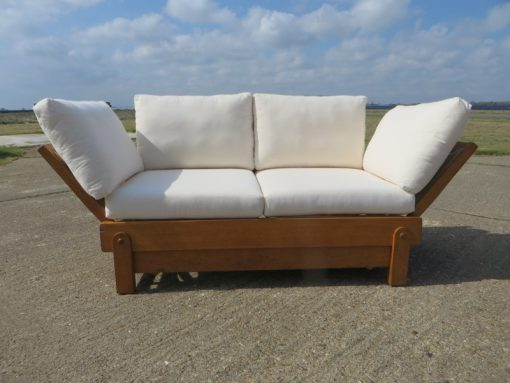 This  Settee-Bed was manufactured by Parker-knoll in the 1930's.  Retailed through Heals and Son London