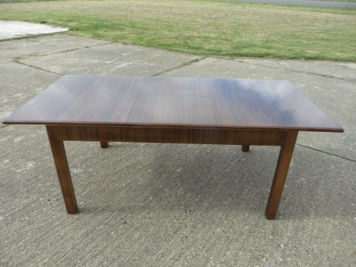 Heals Walnut Drop Leaf table showing fully extended