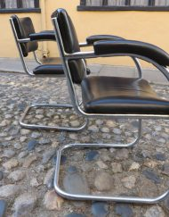 Pair of PEL chrome counter-levered chairs with arms