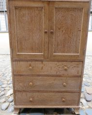 Heals tallboyTwin cupboards over three long graduated drawers